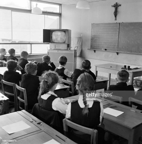 Have put out a schools programme for the first time. At St Gregory's Primary School, Ealing, London. The parents bought a television set for the...