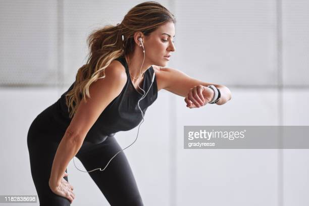 i have some time to do another lap - fitness tracker stock pictures, royalty-free photos & images