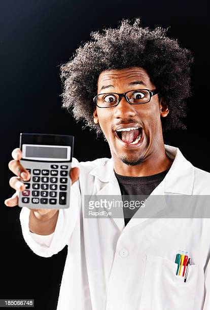 i have the answer! mad scientist with calculator - fun calculator stock photos and pictures