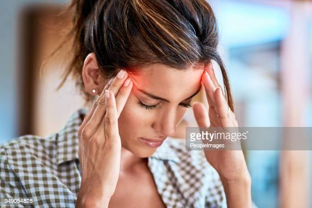i have to keep away from focusing on the pain - headache stock pictures, royalty-free photos & images