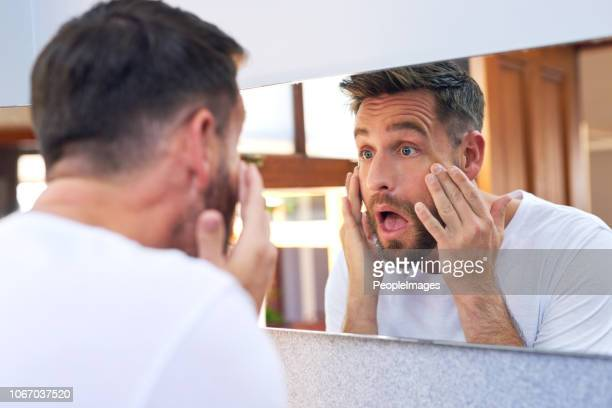 i have wrinkles already?! - look familiar stock pictures, royalty-free photos & images
