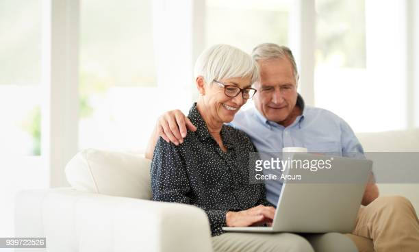 have you seen this? - senior couple stock pictures, royalty-free photos & images