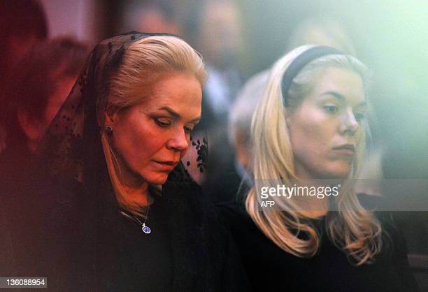 Havel's widow Dagmar Havlova and her daughter Nina Veskrnova attend the private funeral of former Czech President Vaclav Havel at the Strasnice...