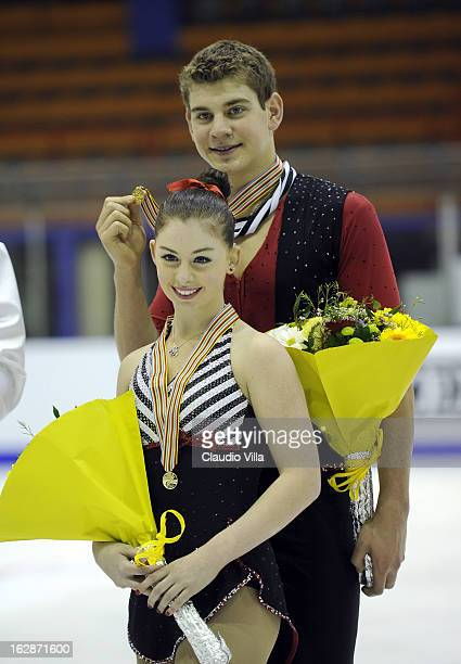Haven Denney and Brandon Frazier of the United States celebrate with their Gold medal at the medal ceremony for the Junior Pairs Free Skating during...