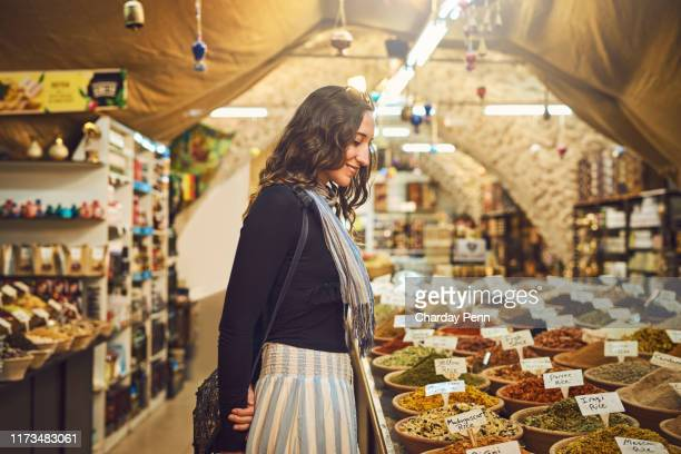 a haven for any foodie - israeli woman stock pictures, royalty-free photos & images