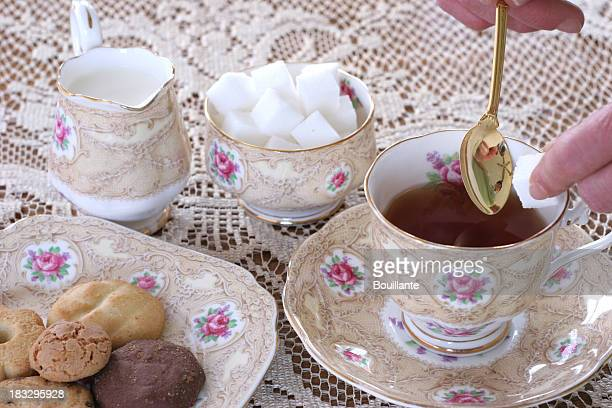 having a cup of tea, - saucer stock pictures, royalty-free photos & images
