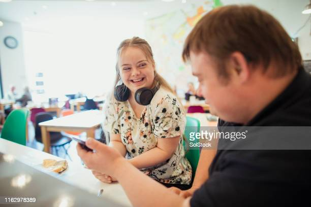 having a date with my mate - down syndrome stock pictures, royalty-free photos & images