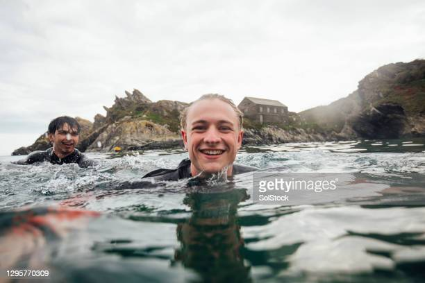 having a dip in the sea - splashing stock pictures, royalty-free photos & images