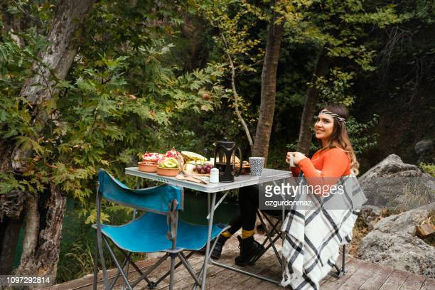having a fresh breakfast in forest - foldable stock pictures, royalty-free photos & images