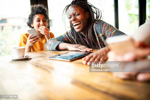 having a good time. - funny black girl stock photos and pictures