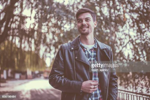 having a great time - biker jacket stock photos and pictures