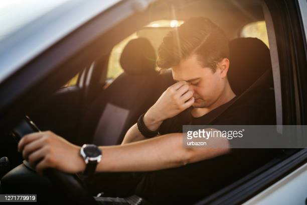 having a headache while driving car - tired stock pictures, royalty-free photos & images
