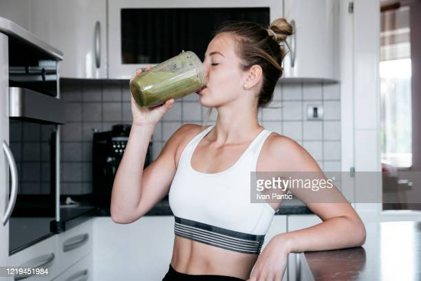 having a healthy breakfast - juice drink stock pictures, royalty-free photos & images