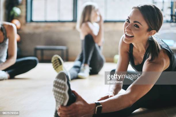 having a laugh while limbering up - gym stock pictures, royalty-free photos & images