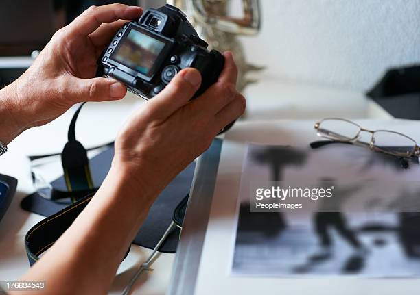 having a look at his new camera - editor stock pictures, royalty-free photos & images