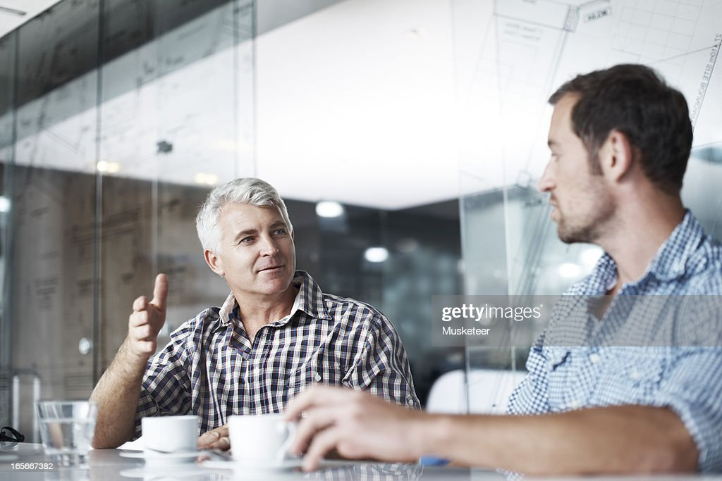 Having a meeting over a cup of coffee : Stock Photo