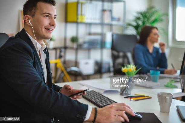 having a nice day in the office - mp3 player stock pictures, royalty-free photos & images
