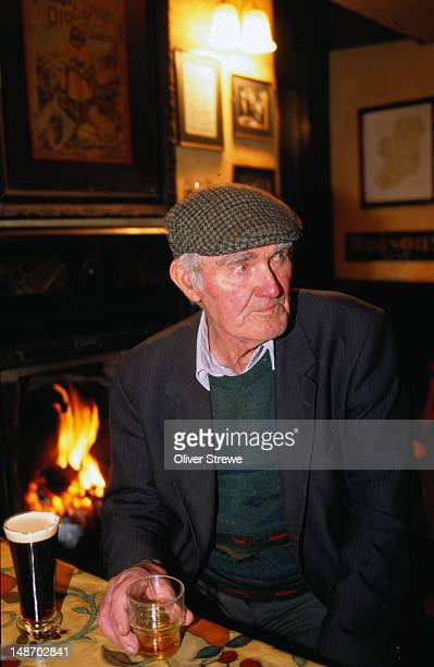 having a pint and a guinness in the pub - county kerry - guinness stock pictures, royalty-free photos & images