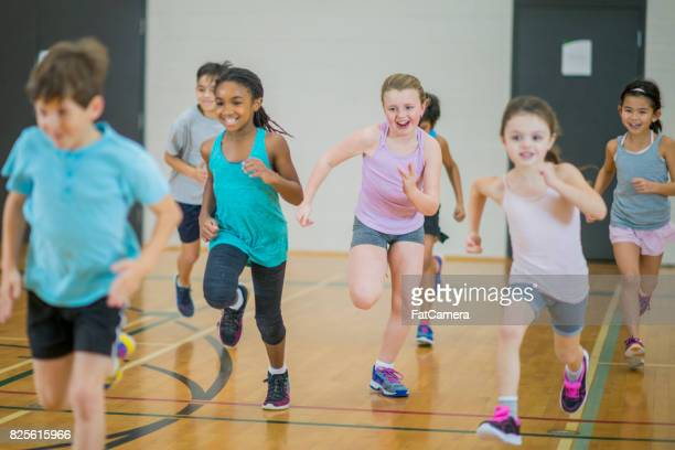 having a race - physical education stock photos and pictures