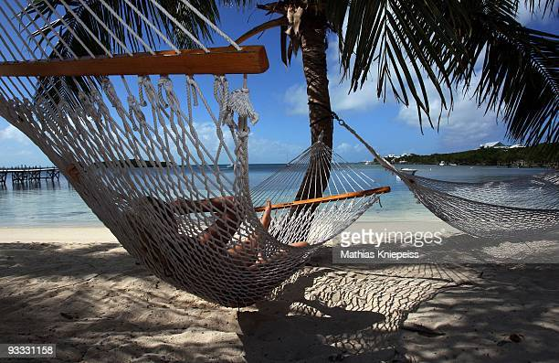 Having a rest in the hammock at the beach und some palms, on November 14, 2008 in Great Guana Cay, Bahamas.
