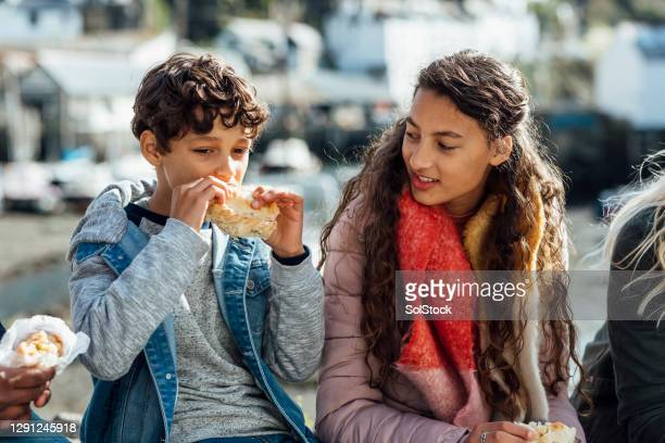having a snack - cornish pasty stock pictures, royalty-free photos & images
