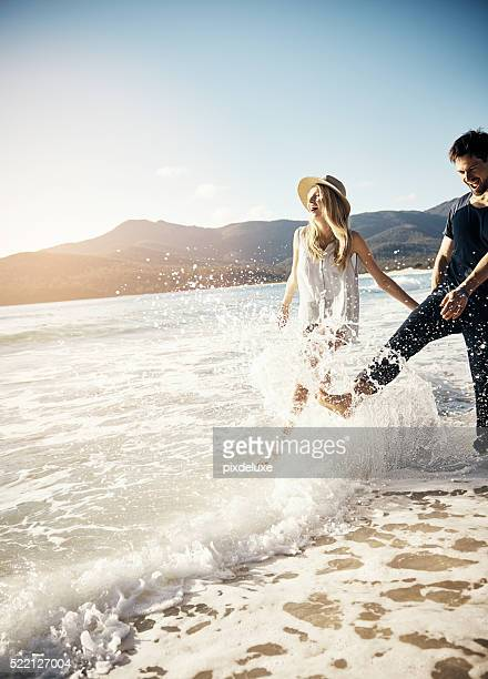 having a splash-tactic time - honeymoon stock pictures, royalty-free photos & images