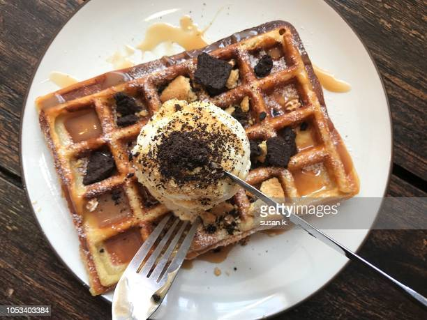 having a super delicious sweet waffle. - table knife stock pictures, royalty-free photos & images