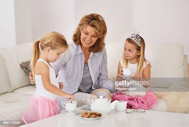 Having a tea party with her grandchildren