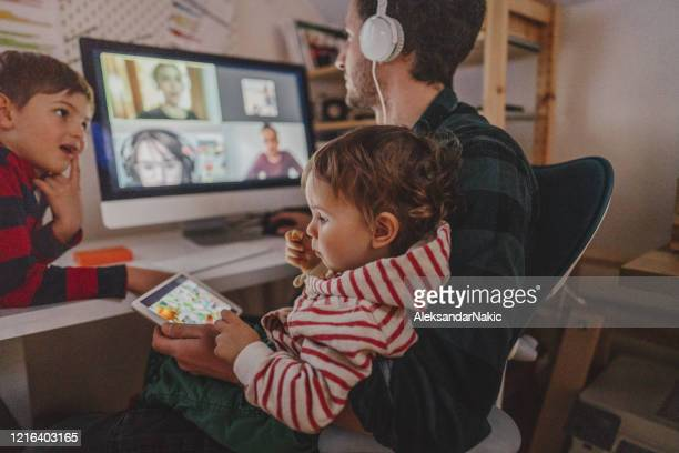 having a video conference call from home - parent stock pictures, royalty-free photos & images