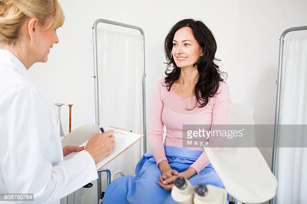 having advise with a gynecologist - pelvic exam stock photos and pictures