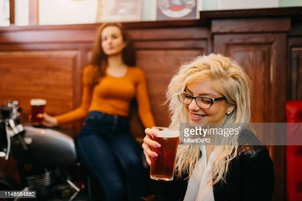 having beer at the pub - irish culture stock pictures, royalty-free photos & images