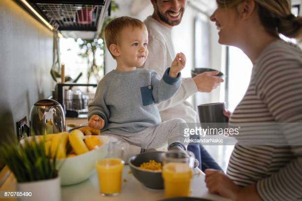 having breakfast in our kitchen - pregnant coffee stock pictures, royalty-free photos & images