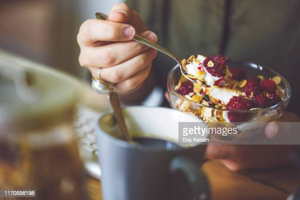 having breakfast - granola stock pictures, royalty-free photos & images