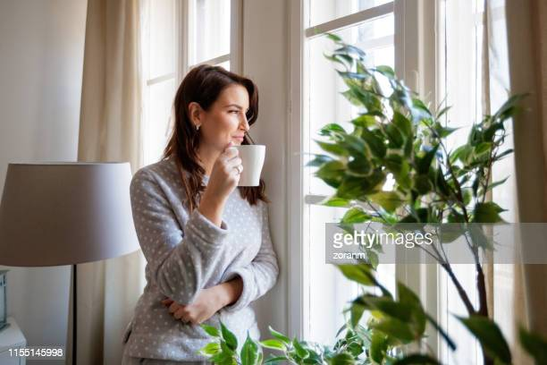 having coffee before the children wake up - looking at view stock pictures, royalty-free photos & images