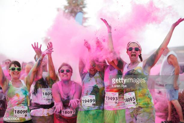 CONTENT] Having completed the race 6 stained smiling exuberant racer participants of the Omaha NE/Council Bluffs IA Color Me Rad Run toss a cloud of...
