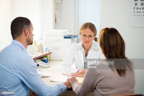 having consultation with general practitioner - cancer stock photos and pictures