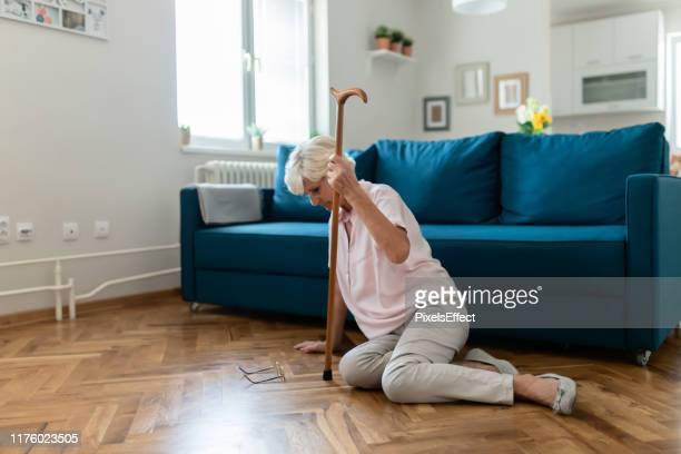 having difficulty staying on her feet - tripping falling stock pictures, royalty-free photos & images