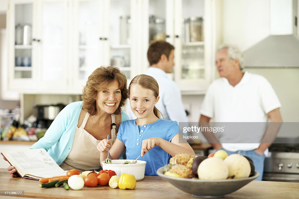 Having fun and learning to cook : Stock Photo
