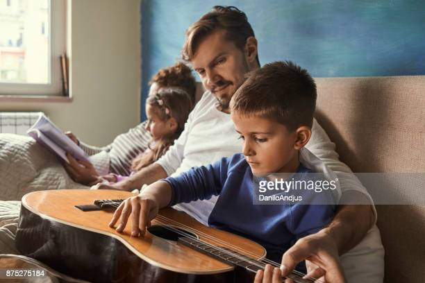 having fun and playing guitar with children