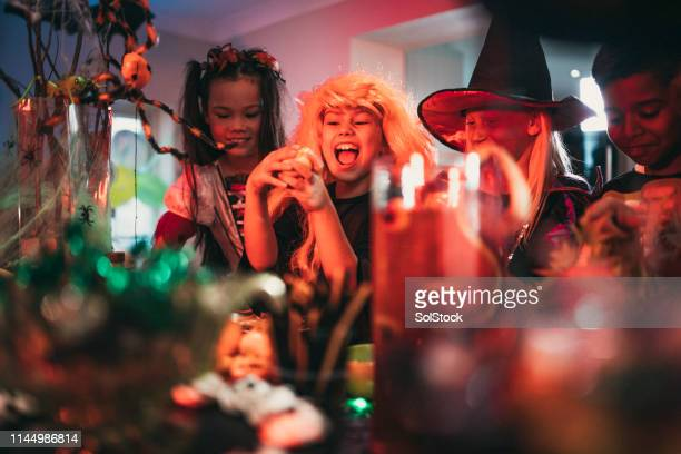 having fun at a halloween party - naughty halloween stock photos and pictures
