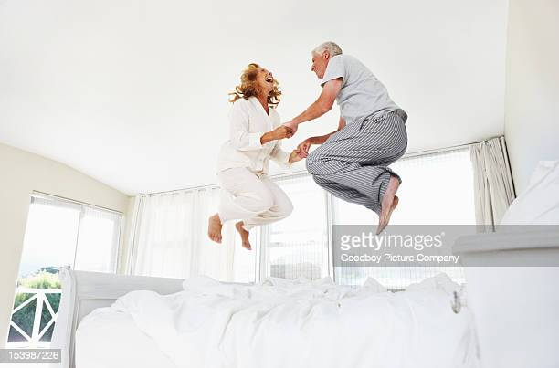 having fun at any age! - jumping stock pictures, royalty-free photos & images
