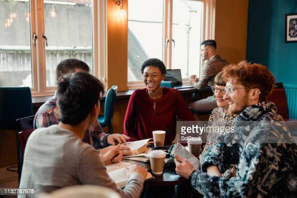 having fun at book club - book club meeting stock pictures, royalty-free photos & images