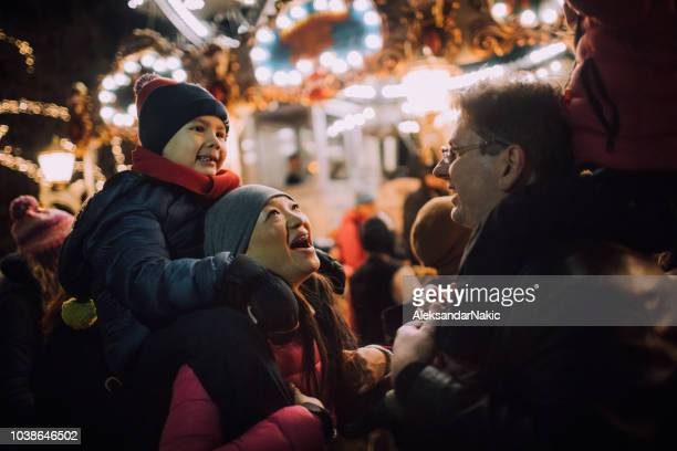 having fun at christmas market - religious christmas stock photos and pictures