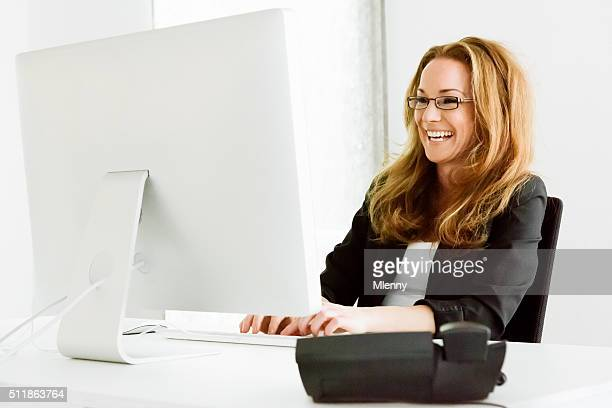Having fun businesswoman laughing reading messages