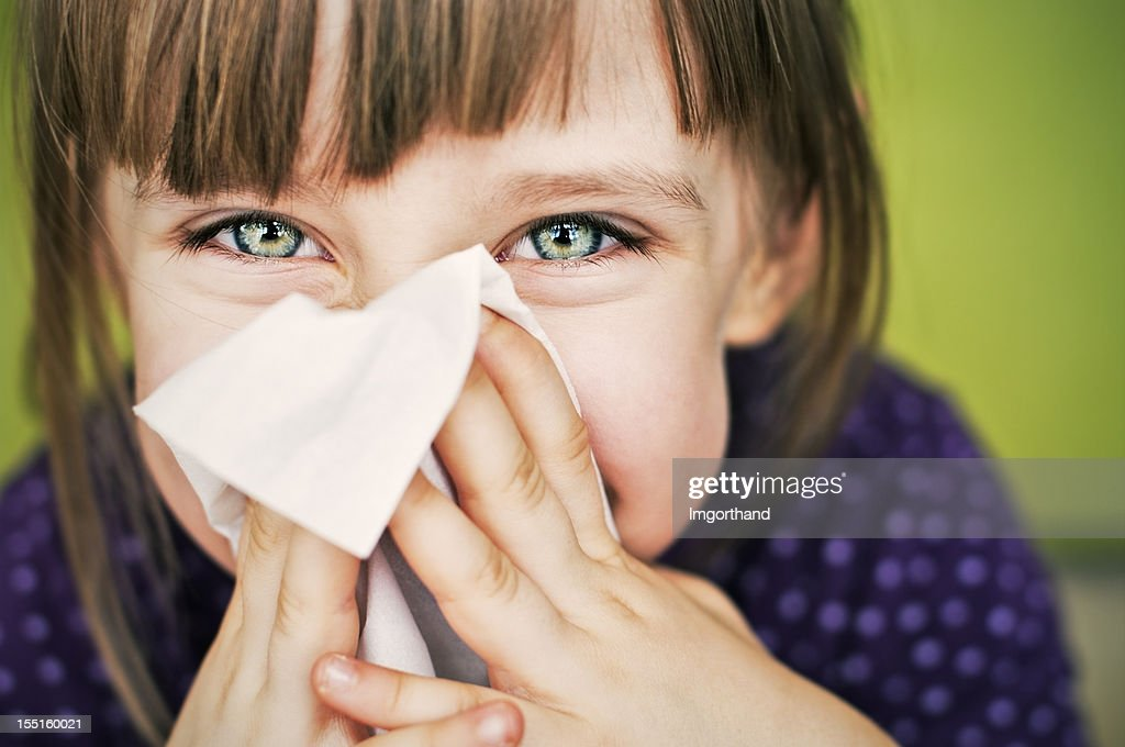 Having fun cleaning nose : Stock Photo
