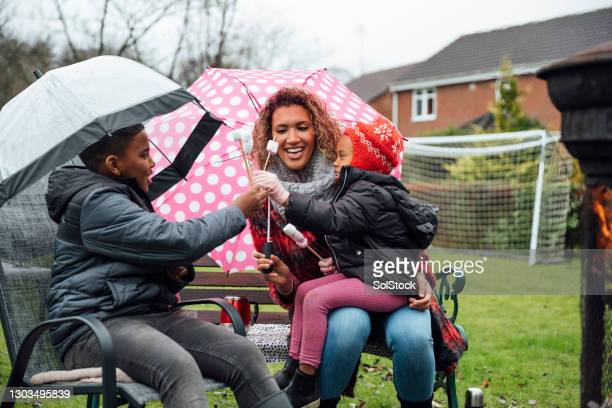 having fun despite the rain - rain stock pictures, royalty-free photos & images