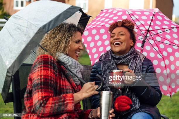 having fun in the rain - rain stock pictures, royalty-free photos & images