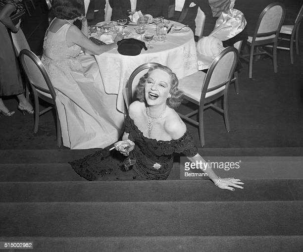 Having Fun New York New York The guest of honor Tallulah Bankhead is pictured at a party given for her tonight by Julious Fleischman owner of the...