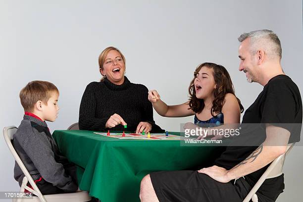 having fun on family game night - game night stock photos and pictures