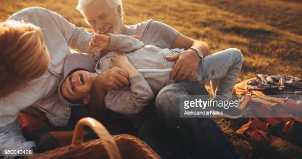 having fun on picnic with my grandparents - tickling stock pictures, royalty-free photos & images